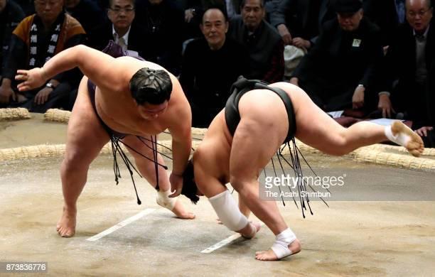 Komusubi Onosho throws Mongolian yokozuna Harumafuji to win during day one of the Grand Sumo Kyushu Tournament at Fukuoka Convention Center on...