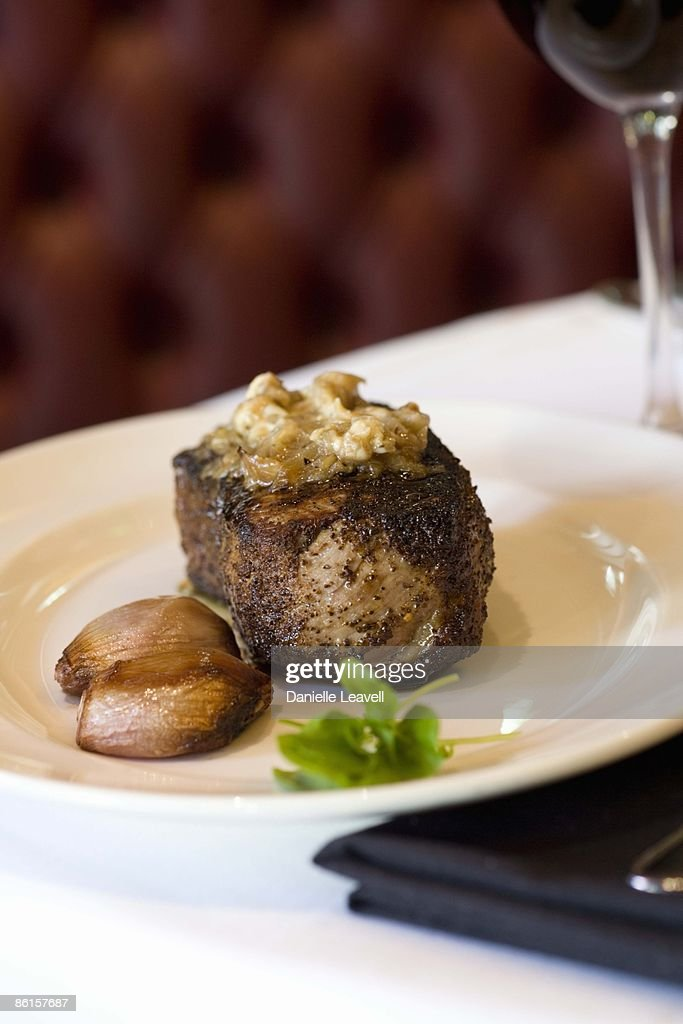 Kona crusted aged sirloin with caramelized shallot butter : Stock Photo