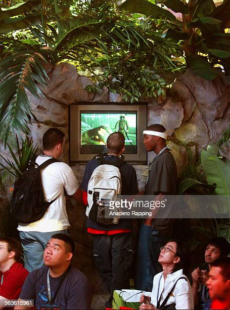 Konami Video Entertainment booth with Metal Gear Solid Snake Eater game set in jungle theme The 2004 Electronic Entertaiment Expo better known as the...