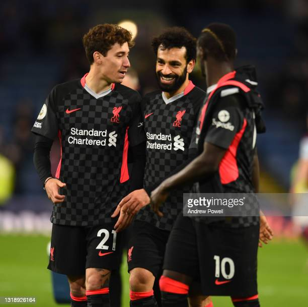 Konastantinos Tsimikas of Liverpool and Mohamed Salah of Liverpool with Sadio Mane of Liverpool at the end of the Premier League match between...