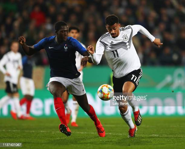 Konate Ibrahima of France challenges Emmanuel Iyoha of Germany during the Germany U21 v France U21 International Friendly match on March 21 2019 in...