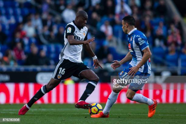 16 Kondogbia from France of Valencia CF defended by 18 Carlos Soler from Spain of Valencia CF during the match of La Liga Santander between RCD...