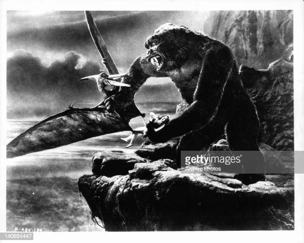 Kong fighting off flying creature while holding Fay Wray in a scene from the film 'King Kong' 1933