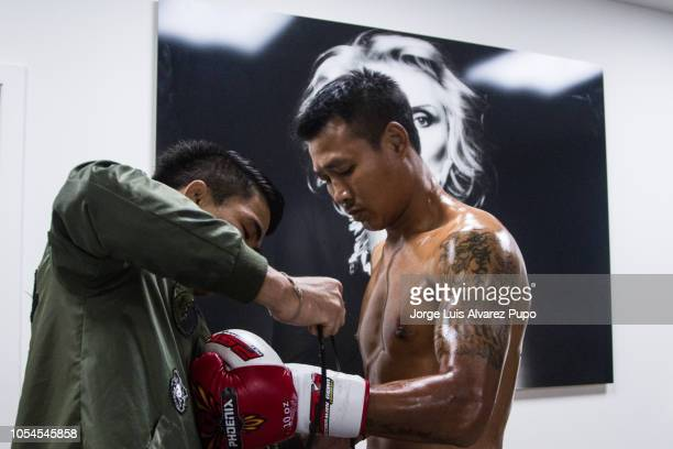 Kongjak Por Paoin of Thailand prepares at the backstage before his 72kg WBC Muay Thai title fight vs Youssef Boughanem at Palais 12 on October 13...