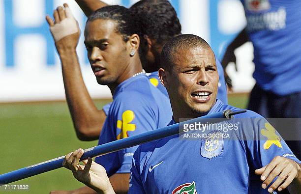 Brazilian striker Ronaldo prepares to throws a mark like a dart 10 June 2006 as teammate Ronaldinho Gaucho looks on during a training session at the...