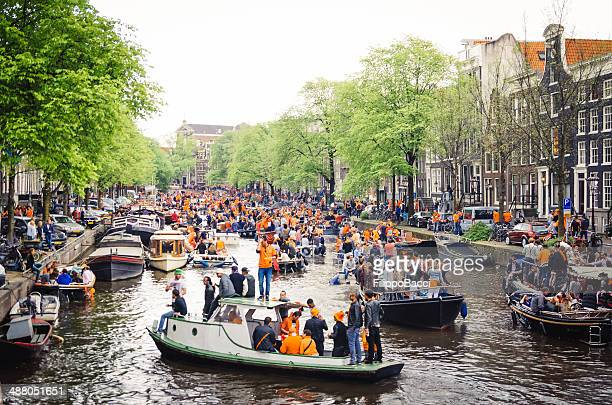 koningsdag 2014 in amsterdam - king's day netherlands stock photos and pictures