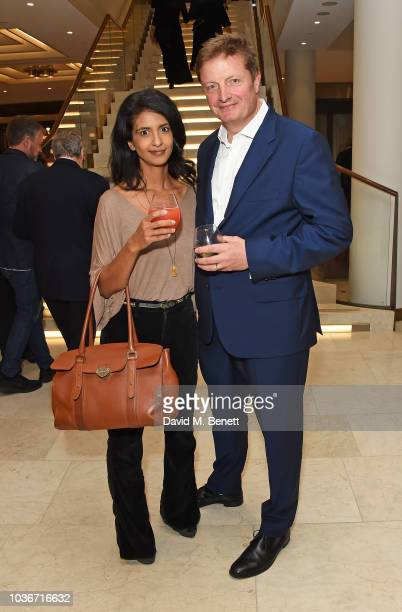 Paul O'Grady and Andre Portasio attend the reopening of the Royal Opera House on September 20 2018 in London England