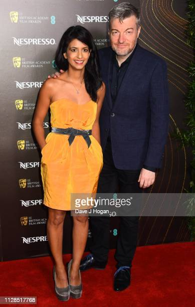 Konnie Huq and Charlie Brooker attend the Nespresso British Academy Film Awards nominees party at Kensington Palace on February 09 2019 in London...