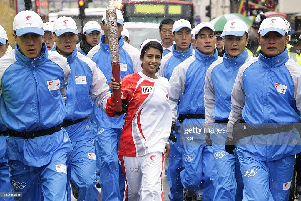 Konnie Huq carries the torch aloft during her leg of the Beijing Olympics torch relay on April 6, 2008 in London, England. The torch for the 2008 Beijing Olympics is to be carried by respected athletes and celebrities from Wembley Arena to the O2 Dome, passing China Town, Trafalgar Square, the Houses of Parliament and London Bridge, amid crowds of spectators. Demonstrations over China?s human rights record and actions in Tibet are expected along the route.