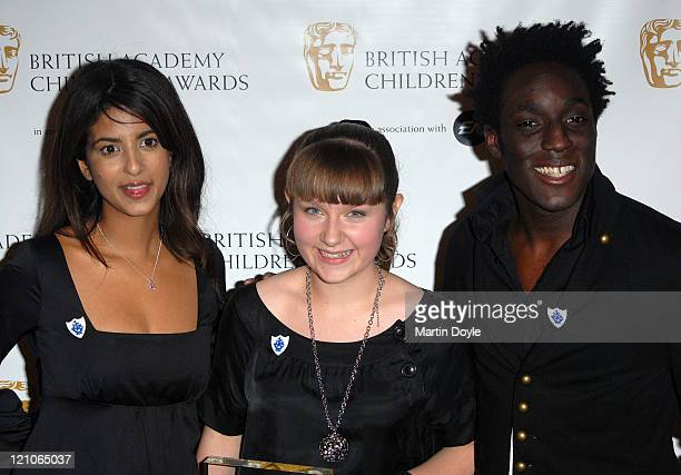 Konnie Huq Rosalind Peters winner of CBBC Me And My Movie The unwelcome Stranger and Andy Akinwolere pose for pictures in the Press Room of 12th...