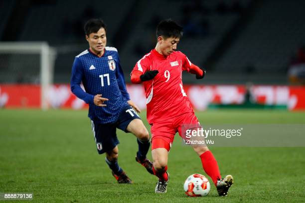 Konno Yasuyuki of Japan and Pak Myong Song of North Korea in action during the EAFF E1 Men's Football Championship between Japan and North Korea at...