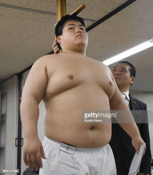 Konosuke Naya 17yearold grandson of the late sumo legend Taiho undergoes a physical checkup at Ryogoku Kokugikan in Tokyo on Jan 10 2018 in order to...
