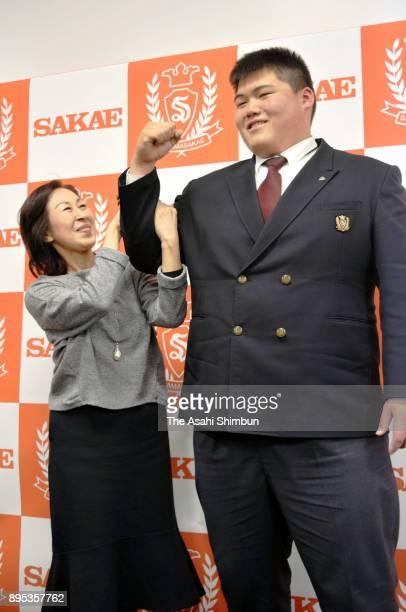 Konosuke Naya grandson of late former yokozuna Taiho poses for photographs with his grandmother Yoshiko during a press conference at Saitama Sakae...