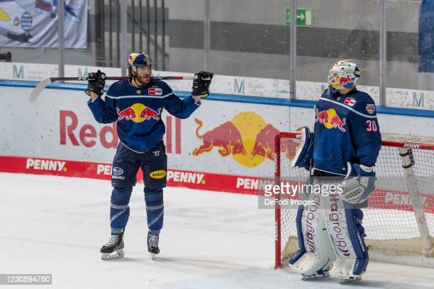 Konrad Abeltshauser of EHC Red Bull Muenchen and goalkeeper Daniel Fiessinger of EHC Red Bull Muenchen look dejected during the DEL match between EHC...