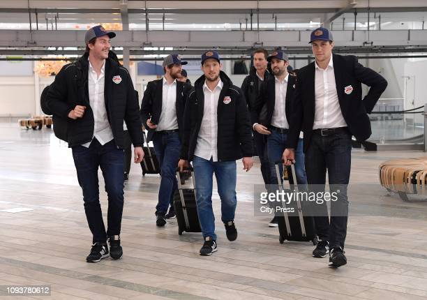 Konrad Abeltshauser, Patrick Hager and Keith Aulie of EHC Red Bull Muenchen during the arrival at the Gothenburg Airport on february 4, 2019 in...