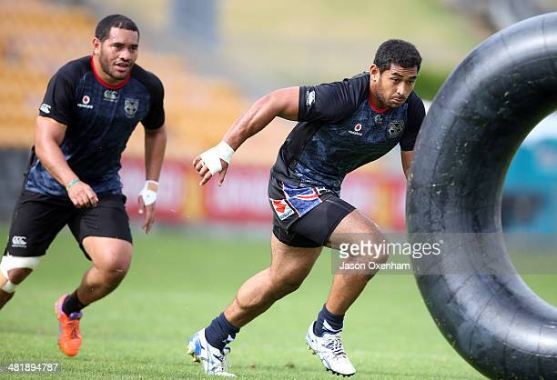 ZEALAND APRIL Konrad Hurrell and Sebastine Ikahihifo of the Warriors practices tackling on a large inner tube during a New Zealand Warriors NRL...