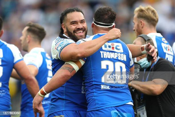 Konrad Hurrell of Leeds Rhinos congratulates teammate Bodene Thompson after scoring their side's second try during the Betfred Super League match...
