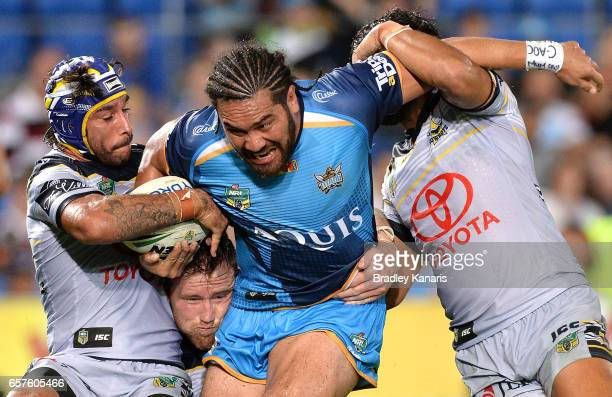 Konrad Hurrell of the Titans attempts to break through the defence during the round four NRL match between the Gold Coast Titans and the North...