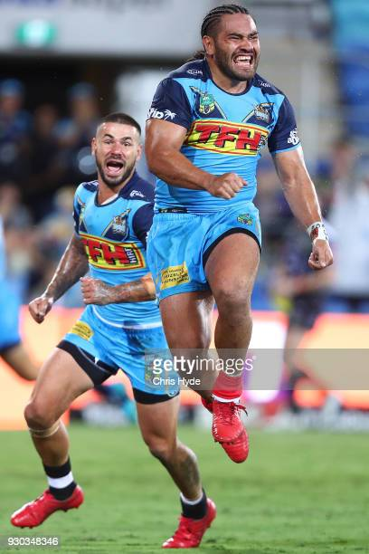 Konrad Hurrell of the Titans celebrates after scoring a try to win the round one NRL match between the Gold Coast Titans and the Canberra Raiders at...