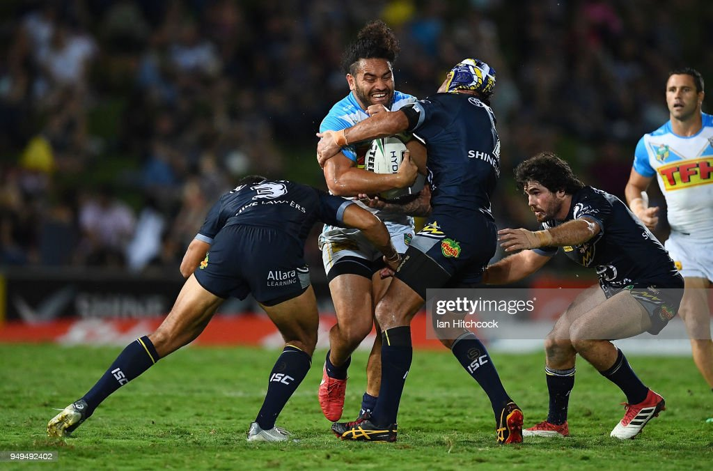 Konrad Hurrell of the Titans is tackled by Johnathan Thurston and Justin O'Neil of the Cowboys during the round seven NRL match between the North Queensland Cowboys and the Gold Coast Titans at 1300SMILES Stadium on April 21, 2018 in Townsville, Australia.