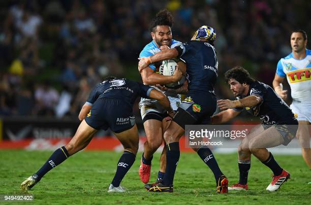 Konrad Hurrell of the Titans is tackled by Johnathan Thurston and Justin O'Neil of the Cowboys during the round seven NRL match between the North...