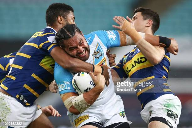 Konrad Hurrell of the Titans is tackled by the Eels defence during the round 21 NRL match between the Parramatta Eels and the Gold Coast Titans at...