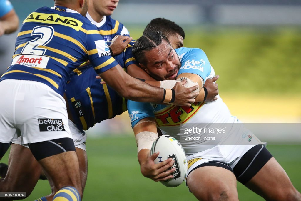 Konrad Hurrell of the Titans is tackled by the Eels defence during the round 21 NRL match between the Parramatta Eels and the Gold Coast Titans at ANZ Stadium on August 4, 2018 in Sydney, Australia.
