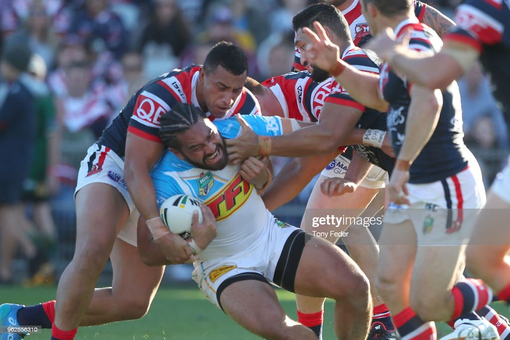 Konrad Hurrell of the Titans is tackled during the round 12 NRL match between the Sydney Roosters and the Gold Coast Titans at Central Coast Stadium on May 26, 2018 in Gosford, Australia.