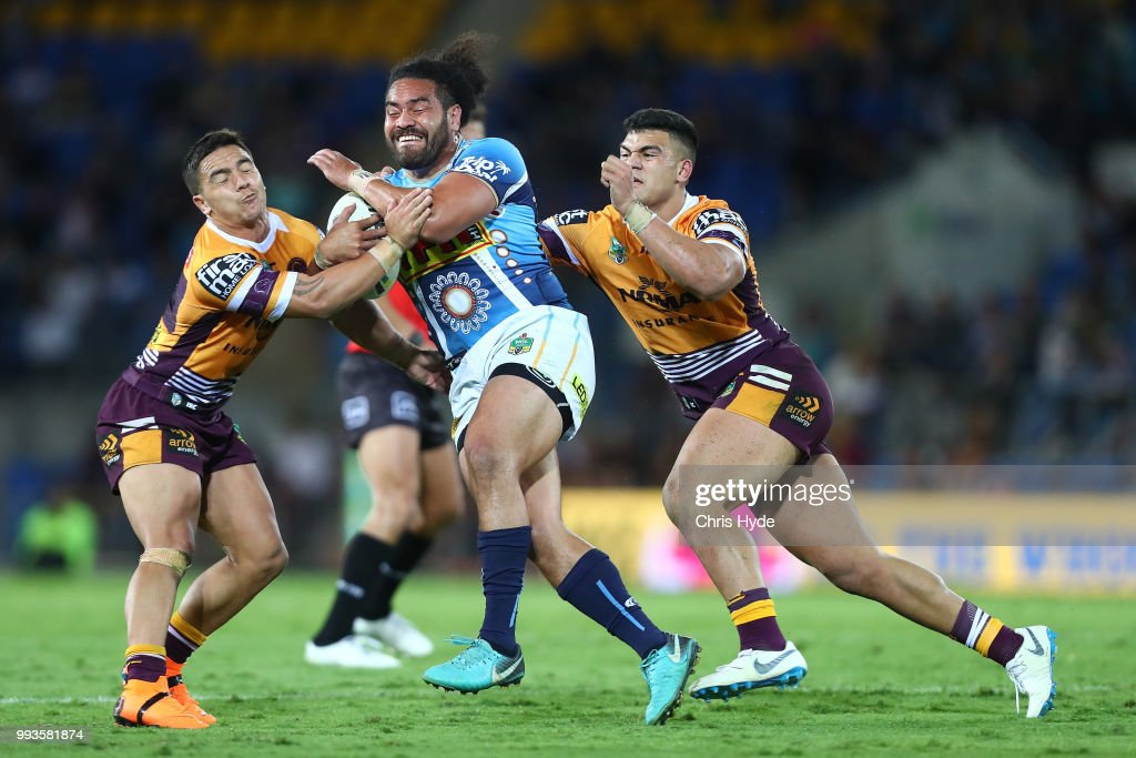 Konrad Hurrell of the Titans is tackled during the round 17 NRL match between the Gold Coast Titans and the Brisbane Broncos at Cbus Super Stadium on July 8, 2018 in Gold Coast, Australia.