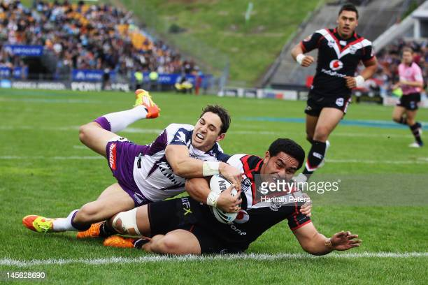 Konrad Hurrell of the Warriors dives over to score a try during the round 13 NRL match between the New Zealand Warriors and the Melbourne Storm at Mt...