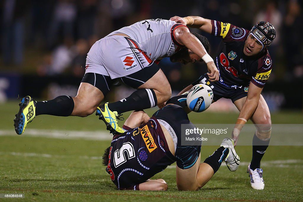 Konrad Hurrell of the Warriors is tackled by Joshua Mansour and Jamie Soward of the Panthers during the round 23 NRL match between the Penrith Panthers and the New Zealand Warriors at Pepper Stadium on August 15, 2015 in Sydney, Australia.