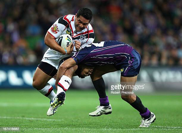 Konrad Hurrell of the Warriors is tackled during the round seven NRL match between the Melbourne Storm and the New Zealand Warriors at AAMI Park on...
