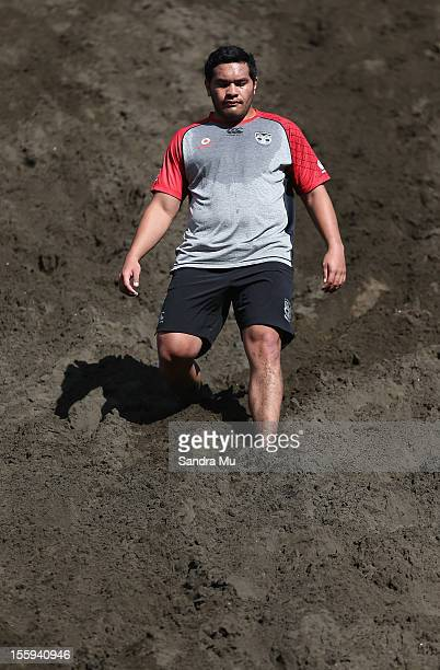 Konrad Hurrell of the Warriors trains on the sand dunes during the New Zealand Warriors NRL training session at Bethells Beach on November 10 2012 in...