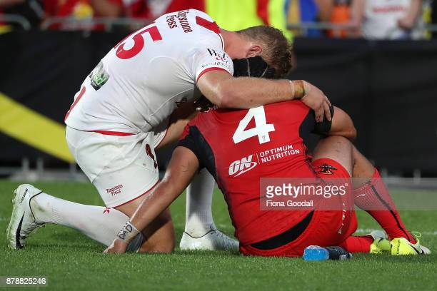 Konrad Hurrell of Tonga is comforted by Thomas Burgess of England during the 2017 Rugby League World Cup Semi Final match between Tonga and England...