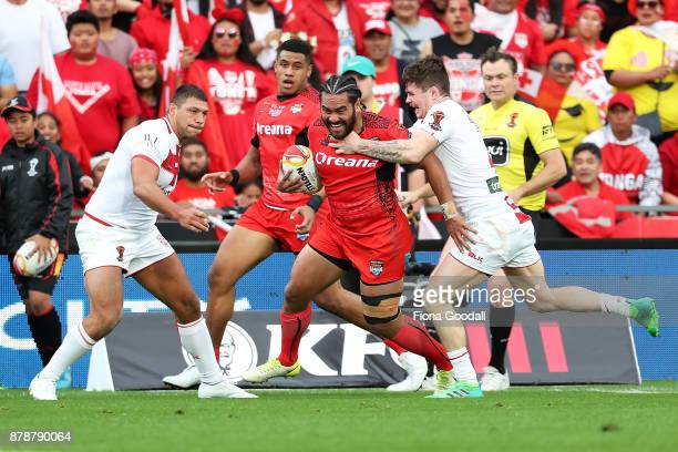 Konrad Hurrell of Tonga is tackled during the 2017 Rugby League World Cup Semi Final match between Tonga and England at Mt Smart Stadium on November...