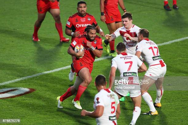 Konrad Hurrell of Tonga meets the England defence during the 2017 Rugby League World Cup Semi Final match between Tonga and England at Mt Smart...