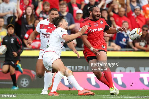 Konrad Hurrell of Tonga passes during the 2017 Rugby League World Cup Semi Final match between Tonga and England at Mt Smart Stadium on November 25...