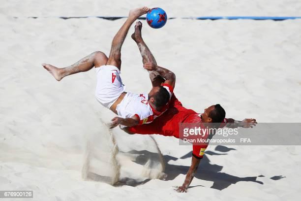 Konrad Kubiak of Poland battles for the ball with Raimoana Bennett of Tahati during the FIFA Beach Soccer World Cup Bahamas 2017 group D match...