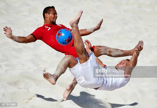 Konrad Kubiak of Poland competes for the ball with Heiarii Tavanae of Tahiti during the FIFA Beach Soccer World Cup Bahamas 2017 group D match...