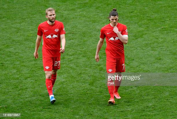 Konrad Laimer and Marcel Sabitzer of RB Leipzig look dejected following their team's defeat in the Bundesliga match between Borussia Dortmund and RB...