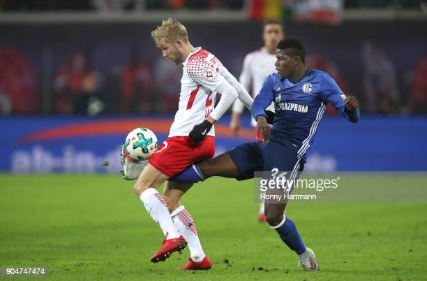 Konrad Laimer of Leipzig and Breel Embolo of Schalke compete during the Bundesliga match between RB Leipzig and FC Schalke 04 at Red Bull Arena on...