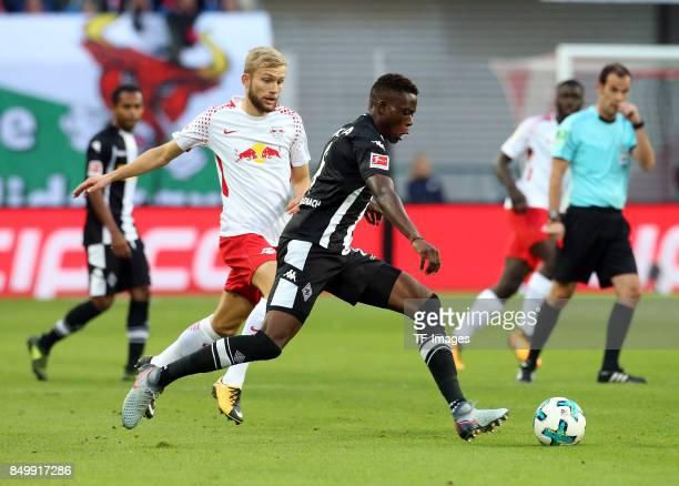 Konrad Laimer of Leipzig and Denis Zakaria of Moenchengladbach battle for the ball during the Bundesliga match between RB Leipzig and Borussia...