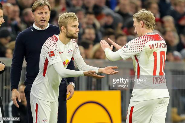 Konrad Laimer of Leipzig and Emil Forsberg of Leipzig gesture during the Bundesliga match between FC Bayern Muenchen and RB Leipzig at Allianz Arena...