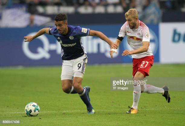 Konrad Laimer of Leipzig and Franco Matias Di Santo of Schalke battle for the ball during the Bundesliga match between FC Schalke 04 and RB Leipzig...