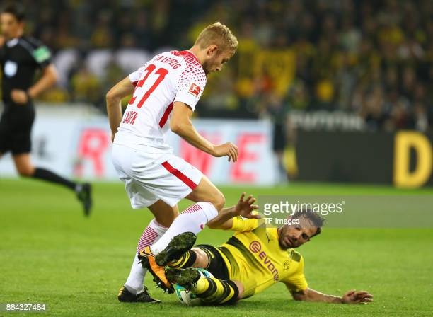 Konrad Laimer of Leipzig and Gonzalo Castro of Dortmund battle for the ball during the Bundesliga match between Borussia Dortmund and RB Leipzig at...