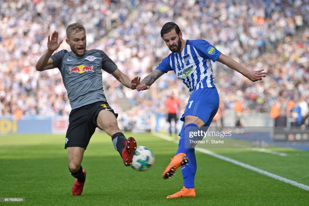 Konrad Laimer (L) of Leipzig and Marvin Plattenhardt of Berlin fight for the ball during the Bundesliga match between Hertha BSC and RB Leipzig at Olympiastadion on May 12, 2018 in Berlin, Germany.