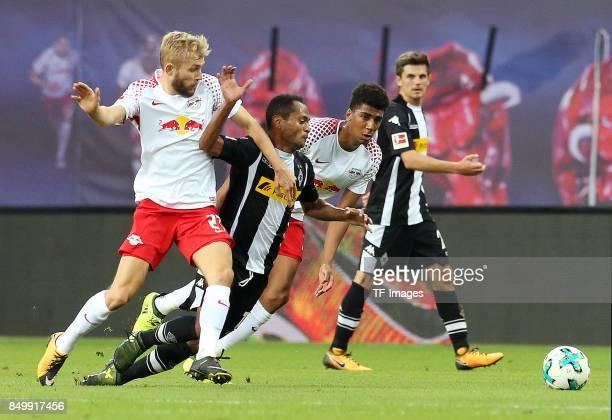 Konrad Laimer of Leipzig and Raffael of Moenchengladbach and Bernardo Fernandes da Silva of Leipzig battle for the ball during the Bundesliga match...
