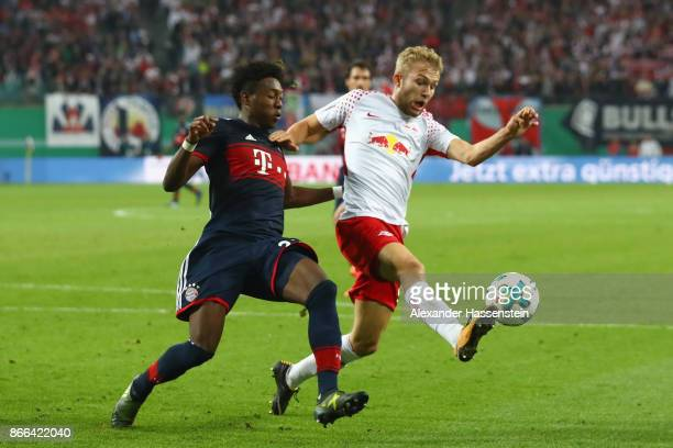 Konrad Laimer of Leipzig battles for the ball with David Alaba of Bayern Muenchen during the DFB Cup round 2 match between RB Leipzig and Bayern...