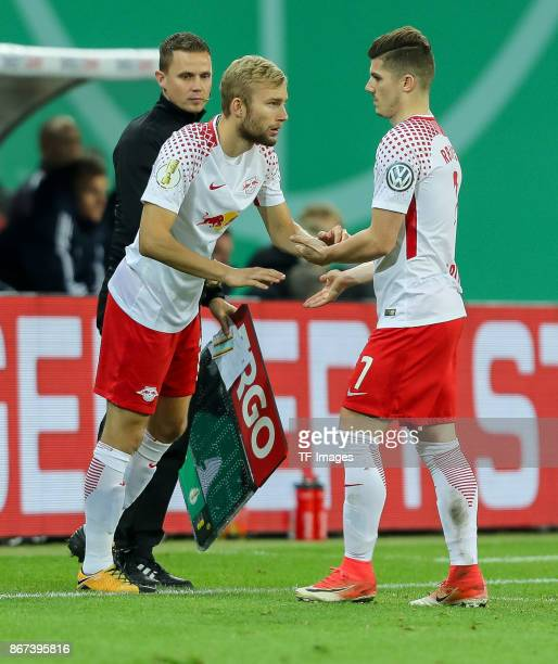 Konrad Laimer of Leipzig comes in and Marcel Sabitzer of Leipzig leaves the soccer field during the DFB Cup round 2 match between RB Leipzig and...