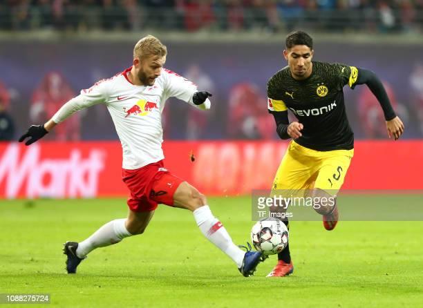 Konrad Laimer of RB Leipzig and Achraf Hakimi of Borussia Dortmund battle for the ball during the Bundesliga match between RB Leipzig and Borussia...